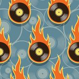 Seamless vector pattern with retro vintage vinyl record icons an. Seamless pattern with retro vintage vinyl record icons and flames. Vector illustration. Ideal Royalty Free Stock Image