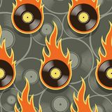 Seamless vector pattern with retro vintage vinyl record icons an. Seamless pattern with retro vintage vinyl record icons and flames. Vector illustration. Ideal Royalty Free Stock Images