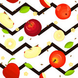 Seamless vector pattern of ripe fruit. Zig zag background with delicious juicy red apples, whole, slice, half, , leaves. Seamless vector pattern of ripe fruit Stock Photography