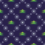 Seamless vector pattern. Seasonal winter symmetrical blue background with snowflakes and fir-trees.  Royalty Free Stock Images