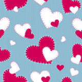 Seamless vector pattern sewn red and white hearts on a blue knitted background. Handmade. Background forValentine`s Day. Stock Images