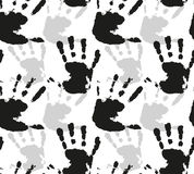 Seamless vector pattern with silhouettes of watercolor prints of children's hands Stock Photos