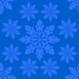 Seamless vector pattern of snowflakes on neutral blue background Royalty Free Stock Photography