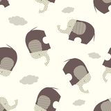 Seamless vector pattern with stylized brown elephants on a beige background. Can be used for textile, website background, book cover, packing Stock Image