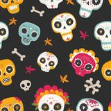 Seamless vector pattern with sugar skulls and flowers. Day of the Dead. Dia de los muertos. Seamless vector pattern with sugar skulls and flowers on dark Stock Images