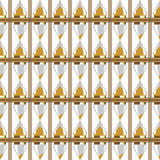Seamless vector pattern. Symmetrical background with closeup gold sand glasses Stock Photo