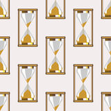 Seamless vector pattern. Symmetrical background with closeup gold sandglasses on the grey backdrop Royalty Free Stock Photos