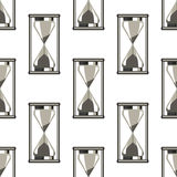 Seamless vector pattern. Symmetrical background with closeup grey sandglasses on the white backdrop Royalty Free Stock Images