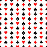 Seamless vector pattern. Symmetrical background with red and black icons of game cards, on the white backdrop Royalty Free Stock Image