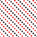 Seamless vector pattern. Symmetrical background with red and black icons of game cards, on the white backdrop Royalty Free Stock Images