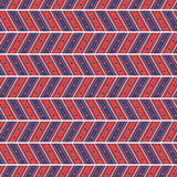 Seamless vector pattern. Symmetrical geometric abstract background with lines and dots in the shape of zigzag in blue and red. Royalty Free Stock Photo
