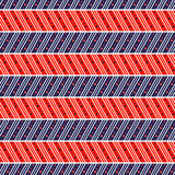 Seamless vector pattern. Symmetrical geometric abstract background with lines and dots in the shape of zigzag in blue and red Stock Image