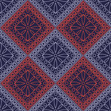 Seamless vector pattern. Symmetrical geometric background with blue and red rhombus and circles on the dark backdrop. Decorative o Royalty Free Stock Photo
