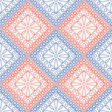 Seamless vector pattern. Symmetrical geometric background with blue and red rhombus and circles on the white backdrop Stock Photography