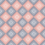 Seamless vector pattern. Symmetrical geometric background with blue and red rhombus on the white backdrop. Decorative ornament Stock Images