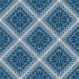 Seamless vector pattern. Symmetrical geometric background with blue rhombus and circles on the dark backdrop. Decorative ornament Stock Photography
