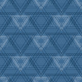 Seamless vector pattern. Symmetrical geometric background with blue triangles in the shape of stars . Decorative repeating ornamen Stock Image