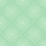 Seamless vector pattern. Symmetrical geometric background with green rhombs and circles. Decorative ornament Stock Photo