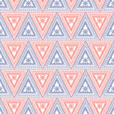 Seamless vector pattern. Symmetrical geometric background with red and blue triangles on the white backdrop. Decorative ornament Royalty Free Stock Photography