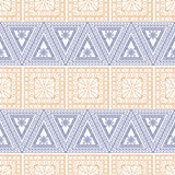 Seamless vector pattern. Symmetrical geometric background with red and blue triangles on the white backdrop. Decorative ornament Royalty Free Stock Photo