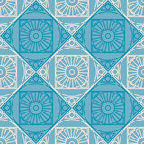 Seamless vector pattern. Symmetrical geometric background with rhombus and circles on the blue backdrop. Decorative repeating orna Stock Photos