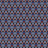 Seamless vector pattern. Symmetrical geometric background with triangles in blue, black and red. Decorative repeating ornament. Royalty Free Stock Images