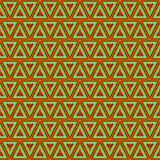 Seamless vector pattern. Symmetrical geometric background with triangles in gree and orange colors . Royalty Free Stock Photography