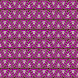 Seamless vector pattern. Symmetrical geometric background with triangles in violet colors. Decorative repeating ornament. Royalty Free Stock Images