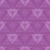 Seamless vector pattern. Symmetrical geometric background with violet triangles in the shape of stars .  Royalty Free Stock Image