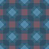 Seamless vector pattern. Symmetrical geometric blue and red background with rhombus, squares and lines. Decorative repeating ornam Royalty Free Stock Image