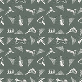 Seamless vector pattern with tools. Hand sketch drawn background with hammers, screws, nuts and wrenches on the grey backdrop Royalty Free Stock Photos