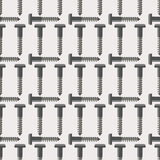 Seamless vector pattern with tools. Symmetrical background with screws on the grey backdrop Royalty Free Stock Photography