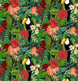 Seamless vector pattern with tropic bird toucan, parrots with exotic flowers and palm leaves. vector illustration