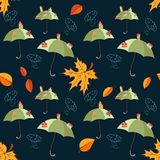 Seamless vector pattern with umbrellas and cities on them, leaves and clouds. On dark background Stock Image