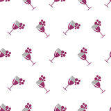 Seamless vector pattern with wineglasses with red wine and bunches of grape on the white background. Royalty Free Stock Photography