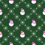 Seamless vector pattern. Winter dark green background with symmetrical white snowmen and snowflakes. Royalty Free Stock Photo