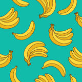 Seamless vector pattern of yellow bananas. On a blue background Royalty Free Stock Photo