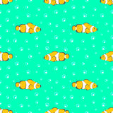 Seamless vector pattern with yellow fishes and bubbles on the green background Stock Image
