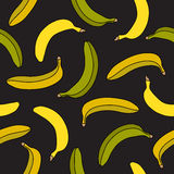 Seamless vector pattern of yellow and green bananas Royalty Free Stock Image