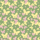 Seamless vector pattern with yellow and pink butterflies. On a green background Royalty Free Stock Photography