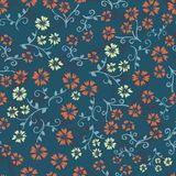 Seamless vector repeating floral pattern. Orange and yellow vintage style flowers on teal blue background. Use for fabric, vector illustration