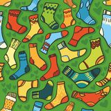 Seamless vector texture - bright baby socks with a Royalty Free Stock Image