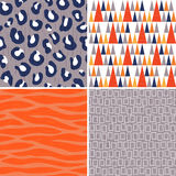 Seamless vector tribal patterns in orange gray and navy. Set of 4 seamless tribal patterns in orange, gray and navy blue with grunge texture. Includes leopard Stock Photos