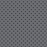 Seamless vector wallpaper of perforated gray metal plate. Royalty Free Stock Image