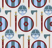 Seamless viking pattern with shields, helmets, axes and swords Royalty Free Stock Photo