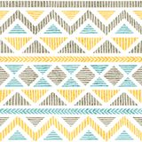 Seamless vintage pattern. Ethnic and tribal motifs. Grunge texture. Gray, blue and yellow geometric elements on a white. Background. Prints for textiles. Vector vector illustration