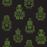 Seamless vintage toy robots pattern. Green on black Stock Photos