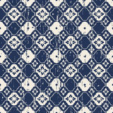 Seamless vintage worn out blue flower tracery pattern background. Stock Image