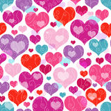 Seamless valentine pattern. Seamless vivid valentine pattern with decorative colorful hearts and curls (vector EPS 10 Stock Photography