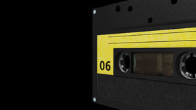 Seamless VJ loop - black yellow retro cassette. 3D stock video